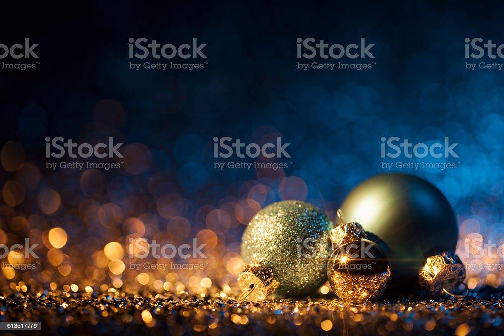 Christmas ornaments on defocused lights. Decorations Bokeh Blue Gold - Photo