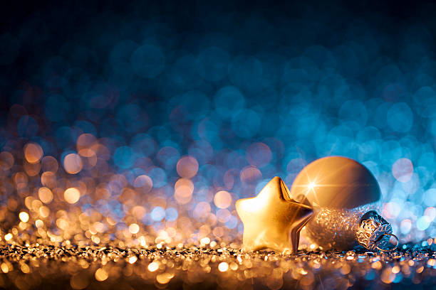 Christmas ornaments on defocused lights. Decorations Bokeh Blue Gold stock photo