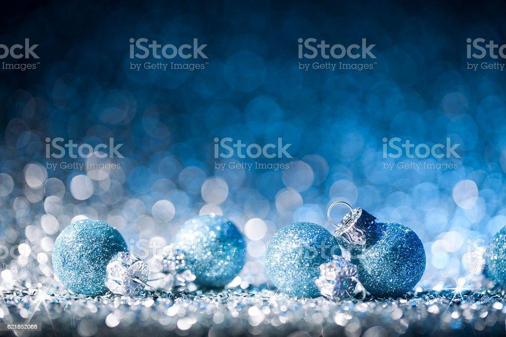 Christmas ornaments on defocused lights. Decorations Bokeh Blue White - Photo