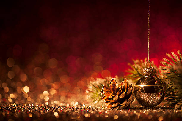 Christmas ornaments on defocused lights. Decorations Bokeh Red Gold - Photo