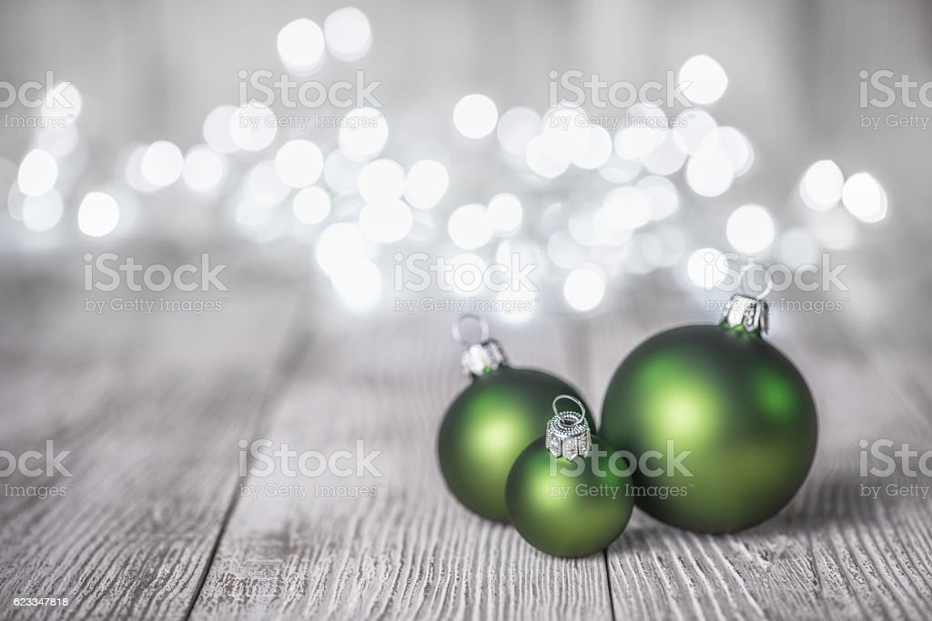Christmas Ornaments on Old Wood Background and defocused lights stock photo