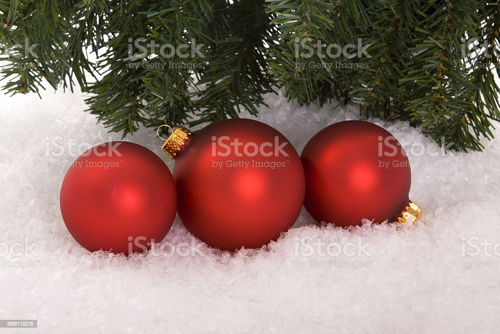 Christmas ornaments on snow royalty-free stock photo