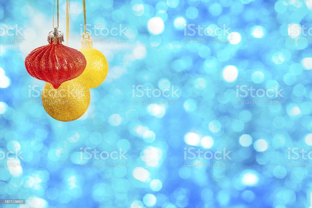 Christmas ornaments warm colors over blue background royalty-free stock photo