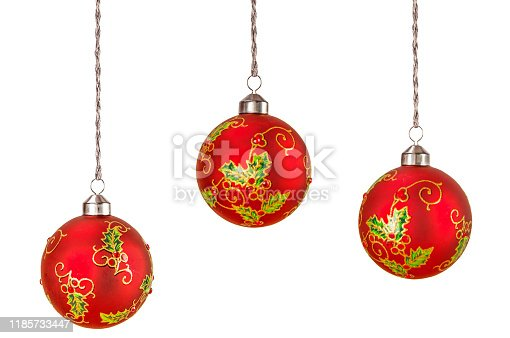 Hanging red Christmas ball isolated on white