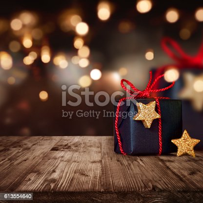 istock Christmas package with festive Background 613554640