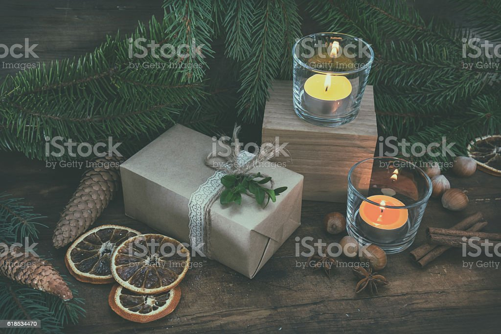 Christmas packages gift and two light candles royalty-free stock photo