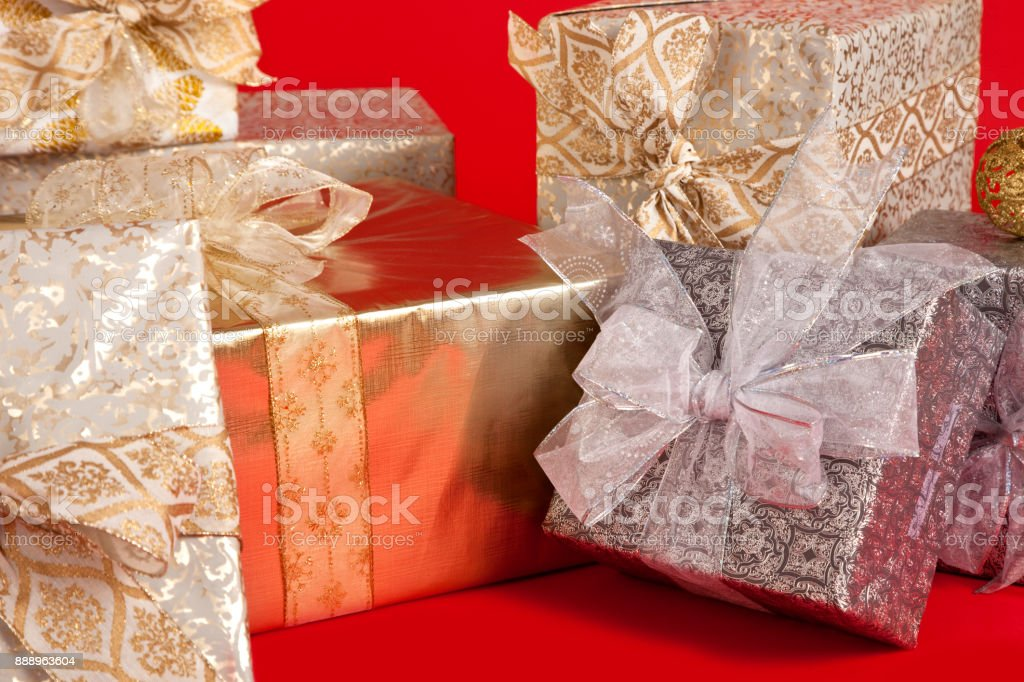 christmas packages with bows wrapped on red background royalty free stock photo - Christmas Packages
