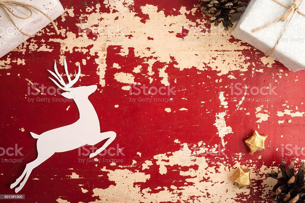 Christmas paper cut deer on vintage wood backdrop stock photo