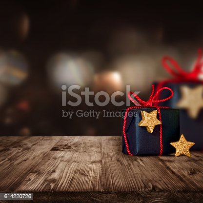 istock Christmas parcels on a wooden Table 614220726