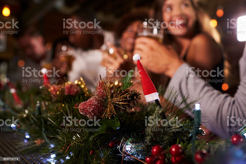 Christmas party at a bar, focus on foreground decorations - foto de stock