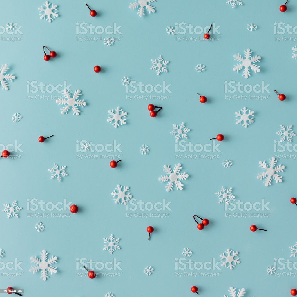 Christmas pattern made of snowflakes and red berries stock photo