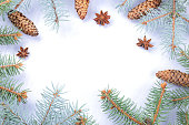 istock Christmas pattern with fir branches, fir cones and anise. Blank for holiday cards. Christmas branches on white background. Copy space 1060225078