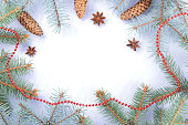 istock Christmas pattern with fir branches, fir cones and anise. Blank for holiday cards. Christmas branches on white background. Copy space 1060225106