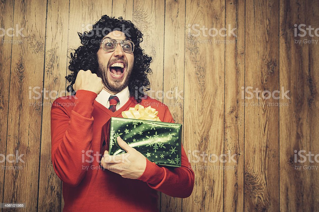 Christmas Perm Guy Celebrates a Gift stock photo