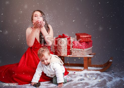 Baby boy and young woman with Christmas decoration