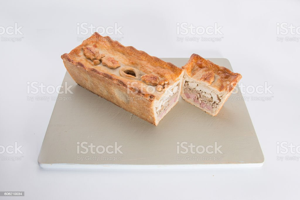 Christmas pie,    holly leaf and berry decoration on the top, stock photo