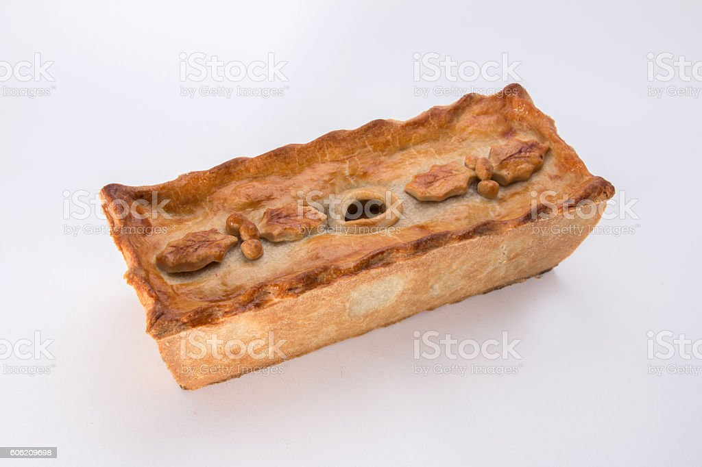 Christmas pie,     holly leaf and berry decoration stock photo