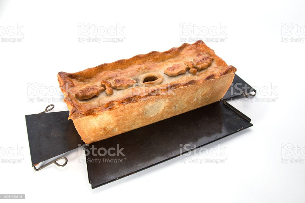 Christmas Pie,  on the baking tin decorated with Holly leaves stock photo