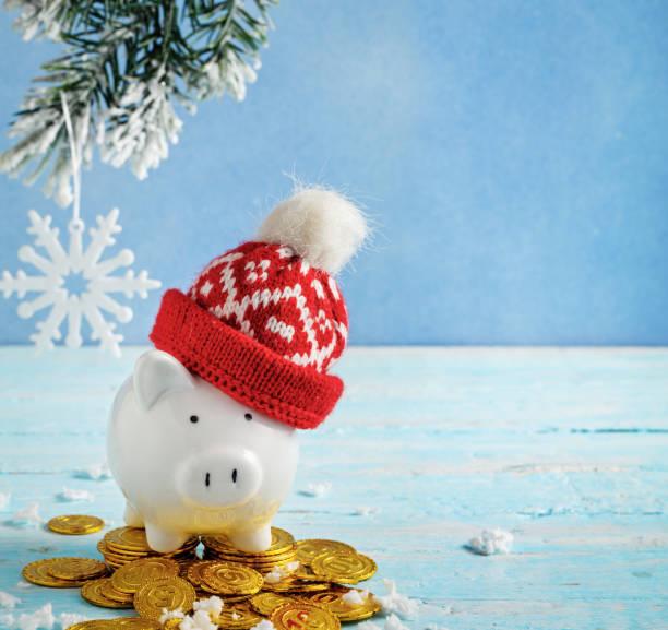 Cтоковое фото Christmas piggy bank on blue