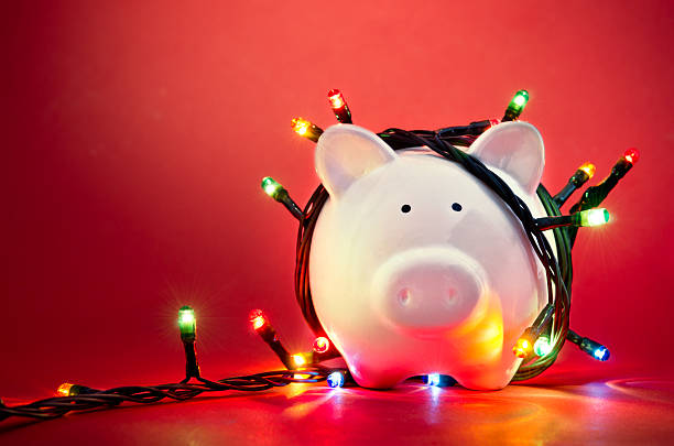 christmas piggy bank - commercial activity stock photos and pictures