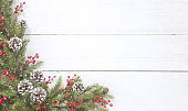 Christmas pine garland border on an old white wood background