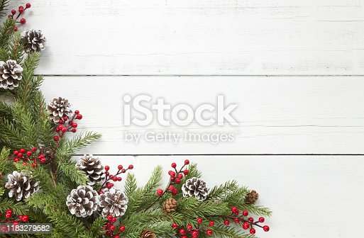 istock Christmas pine garland border on an old white wood background 1183279582