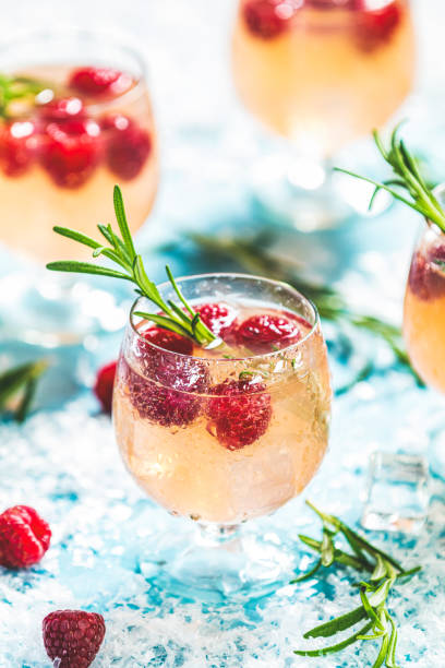 Christmas pink drink raspberry with rosemary and ice stock photo