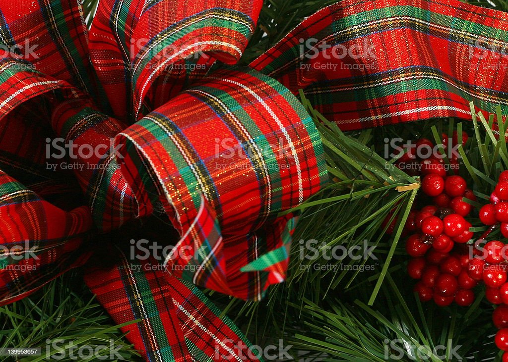 christmas plaid bow & berries stock photo
