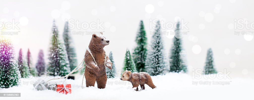 Christmas polar and grizzly bears in Snowy Winter Forest stock photo