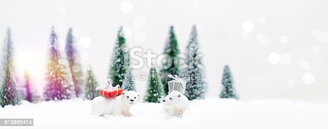 istock Christmas polar and grizzly bears in Snowy Winter Forest 615885414