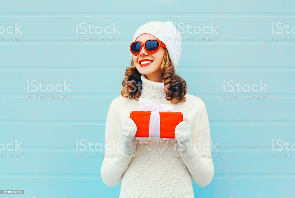 Christmas portrait happy smiling woman with gift box stock photo