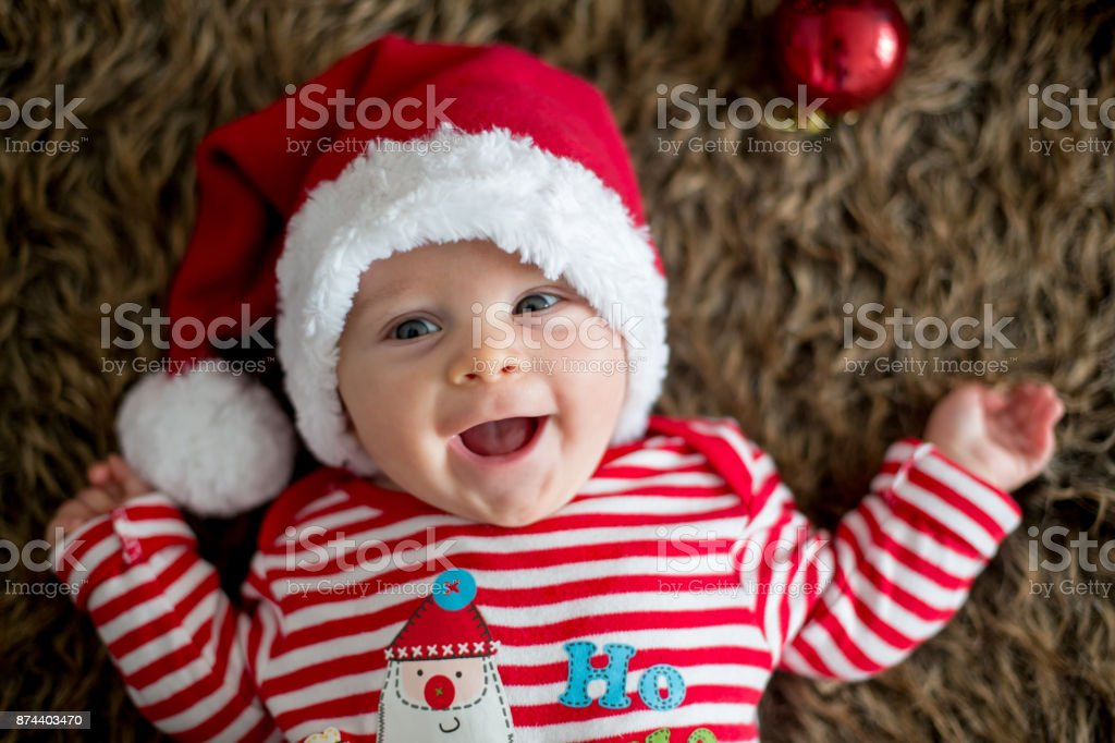 Christmas portrait of cute little newborn baby boy stock photo