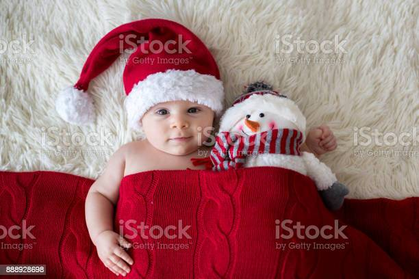 Christmas portrait of cute little newborn baby boy wearing santa hat picture id888928698?b=1&k=6&m=888928698&s=612x612&h=4j5ix308sxedax4x0yahe7dsrhunjpi3yfc2iinwhc4=