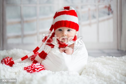 Christmas Portrait Of Cute Little Newborn Baby Boy Wearing Santa Hat