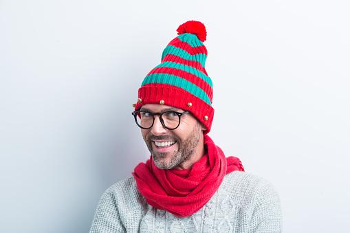 Christmas Portrait Of Happy Nerdy Man Wearing Elf Cap Stock Photo - Download Image Now