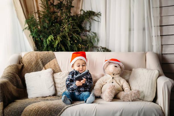 Christmas portrait of happy smiling little boy in red santa hat on picture id896446812?b=1&k=6&m=896446812&s=612x612&w=0&h=w 2bstgt56j2 c46vzvqbqah5oie8ouqfz5tqtflzje=