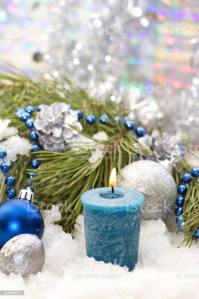 Christmas postcard with candle and christmas decoration