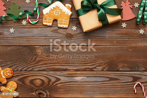 istock Christmas present and decoration on wooden background 615727802