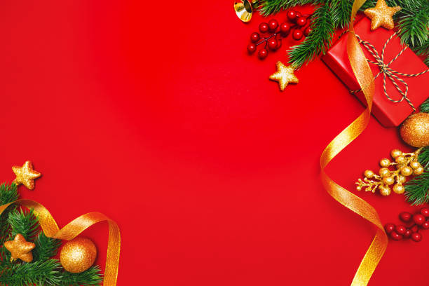 Christmas present and pine tree with xmas decoration on Red background stock photo