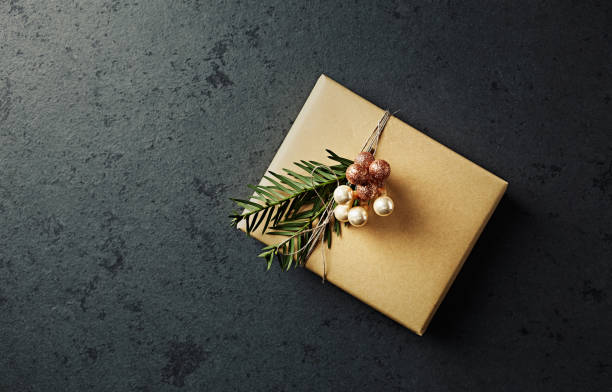 Christmas present decorated with yew twigs stock photo