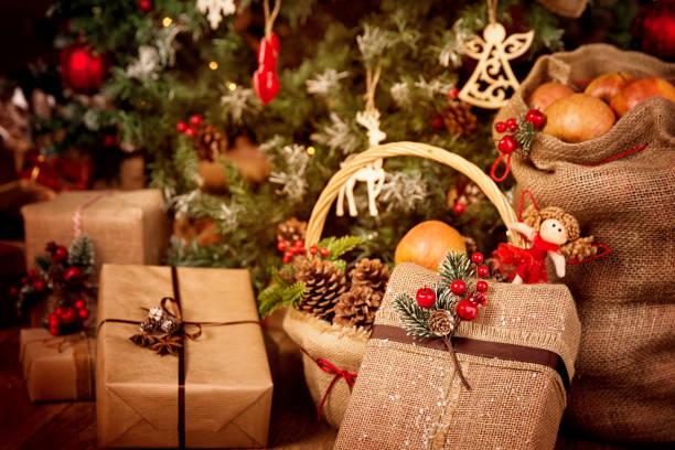 Christmas Present Gifts Decoration, Xmas Tree Scene with Retro Burlap Decor, red berry pine cones toys stock photo