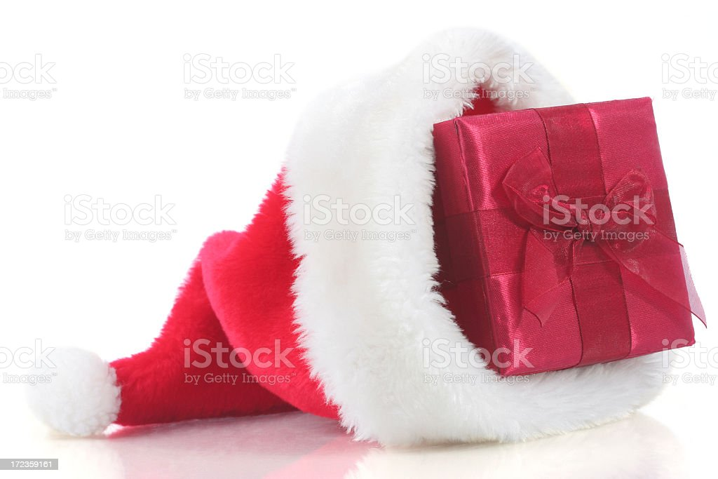 Christmas present in Santa hat royalty-free stock photo