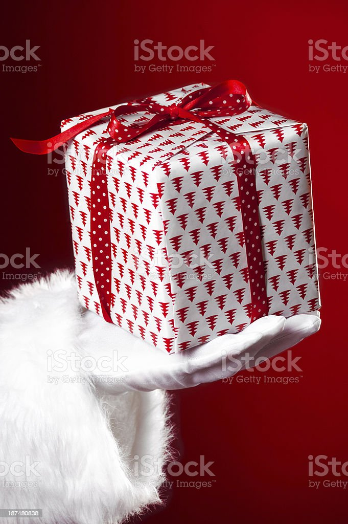 Christmas present in Santa's hand royalty-free stock photo