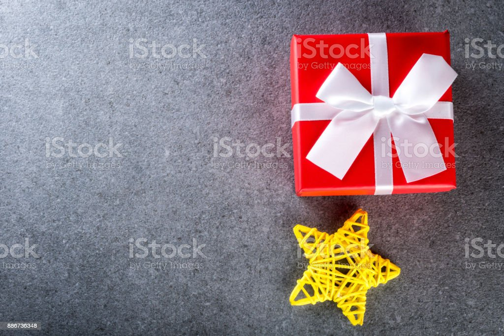 Christmas present on dark background in vintage style. Christmas decor and gift for a loved one. Empty space for copypast stock photo