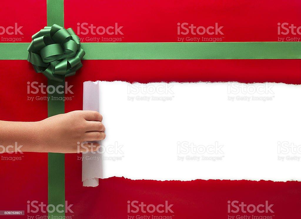 Christmas Present Torn Open stock photo