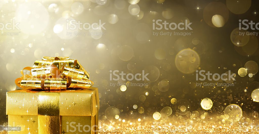Christmas Present With Golden Sparkling Background stock photo