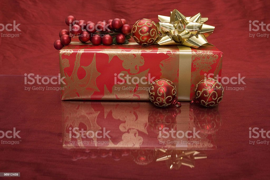 Christmas present with ornament and holly royalty-free stock photo