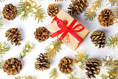 istock Christmas present with pine cones festive background 894693852