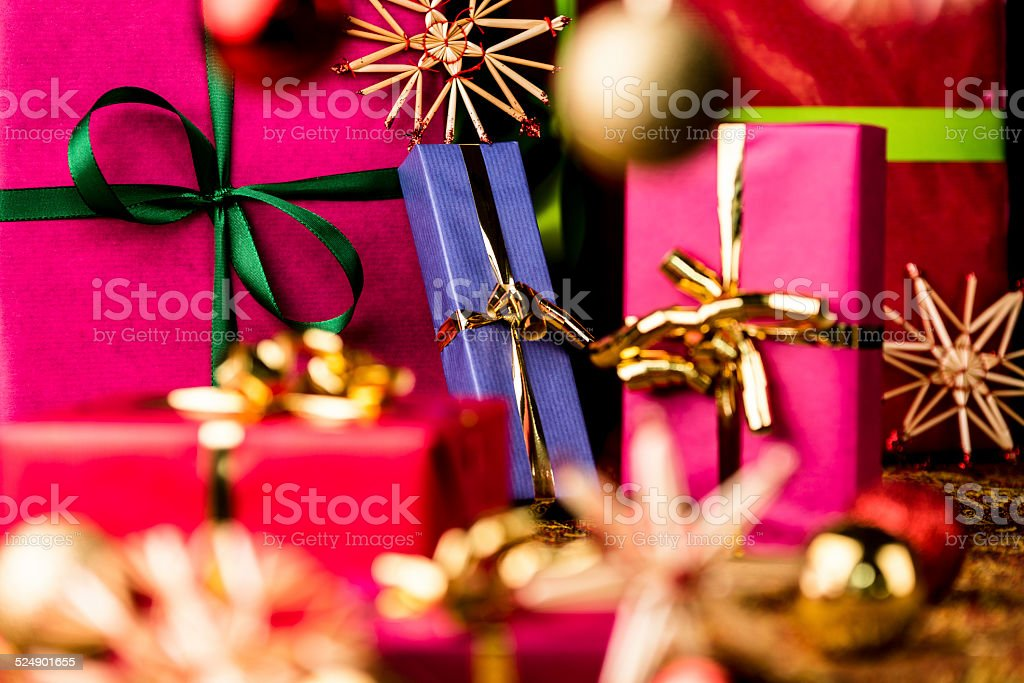 Christmas Presents amidst Baubles and Stars stock photo