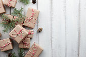 istock Christmas presents and gift boxes wrapped in kraft paper 875454114